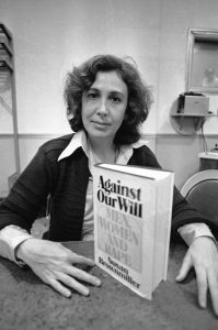"Susan Brownmiller, poses with her book in New York, Oct. 18, 1975. The book, ""Against Our Will - Men, Women and Rape"" is a prodigious analysis of the history and meaning of rape and has been hailed as the most important feminist treatise since ""Sexual Politics"" and ""The Female Eunuch"". (AP Photo/Suzanne Vlamis)"